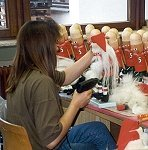 fur beards are added along with fabric coats to complete these Santa nutcrackers at the Ulbricht factory.