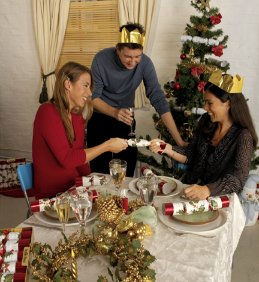 Silly paper hats and jokes within are a major part of this Anglo Christmas Dinner tradition.