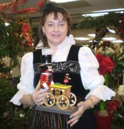 Karla Steinbach holding a vintage Organ Grinder nutcracker with music box.