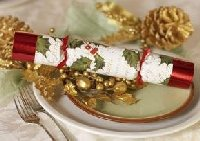 Holiday table place setting with English Christmas Cracker