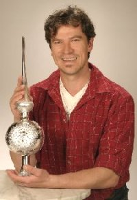 Thomas Ziesmer, Master glass blower at Inge-glas holds a large silvered tree finial - tree topper.
